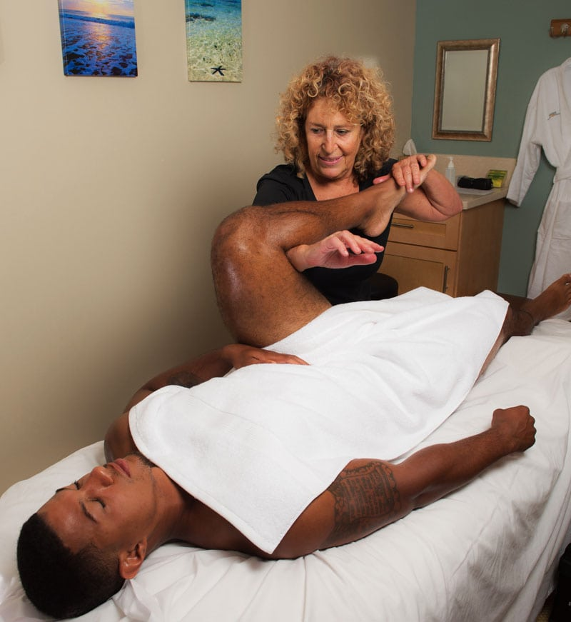 San Diego Sports Massage, Woman stretching man's leg
